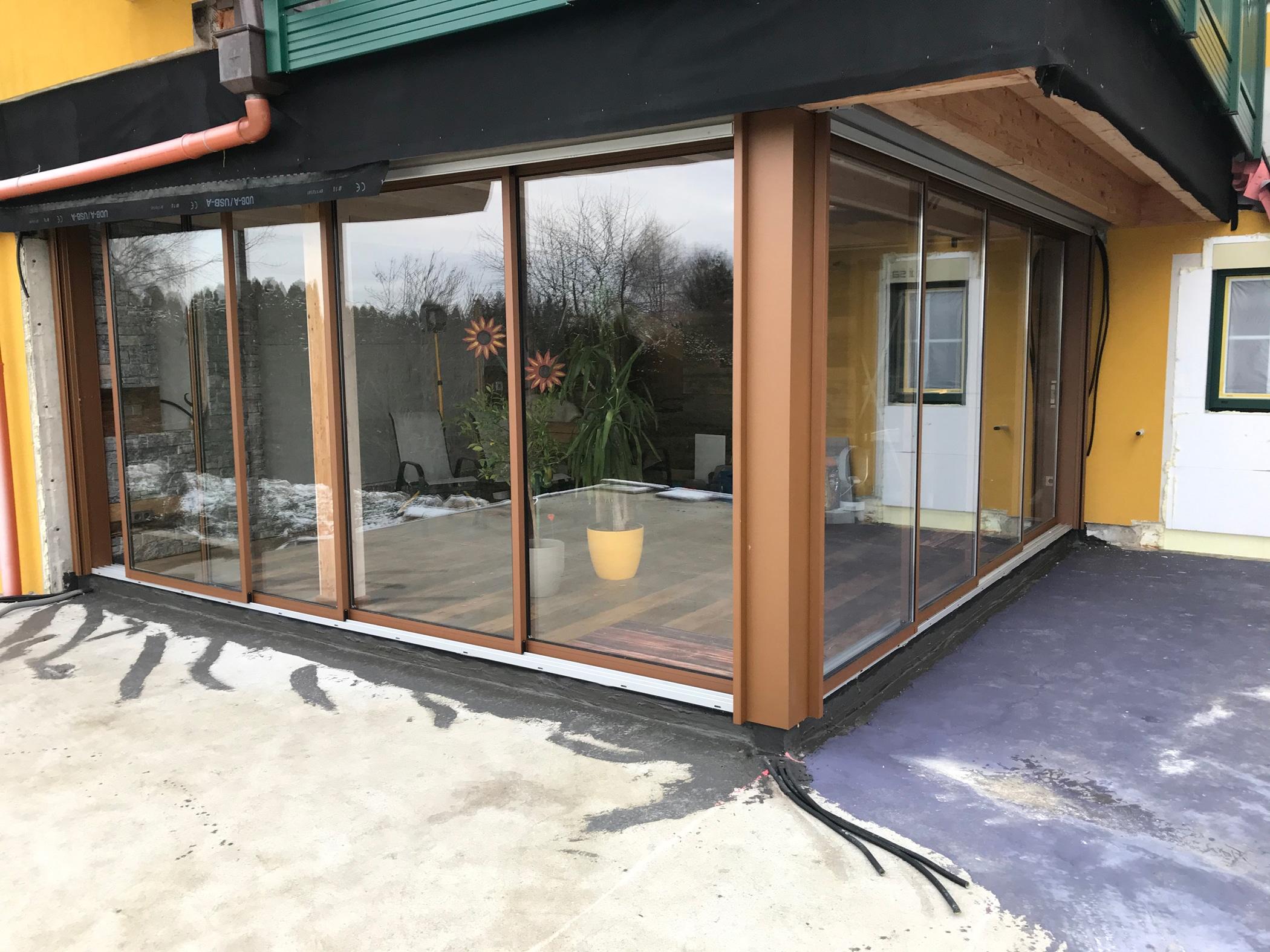 Erweiterung mit Terrassenverglasung zum Schieben