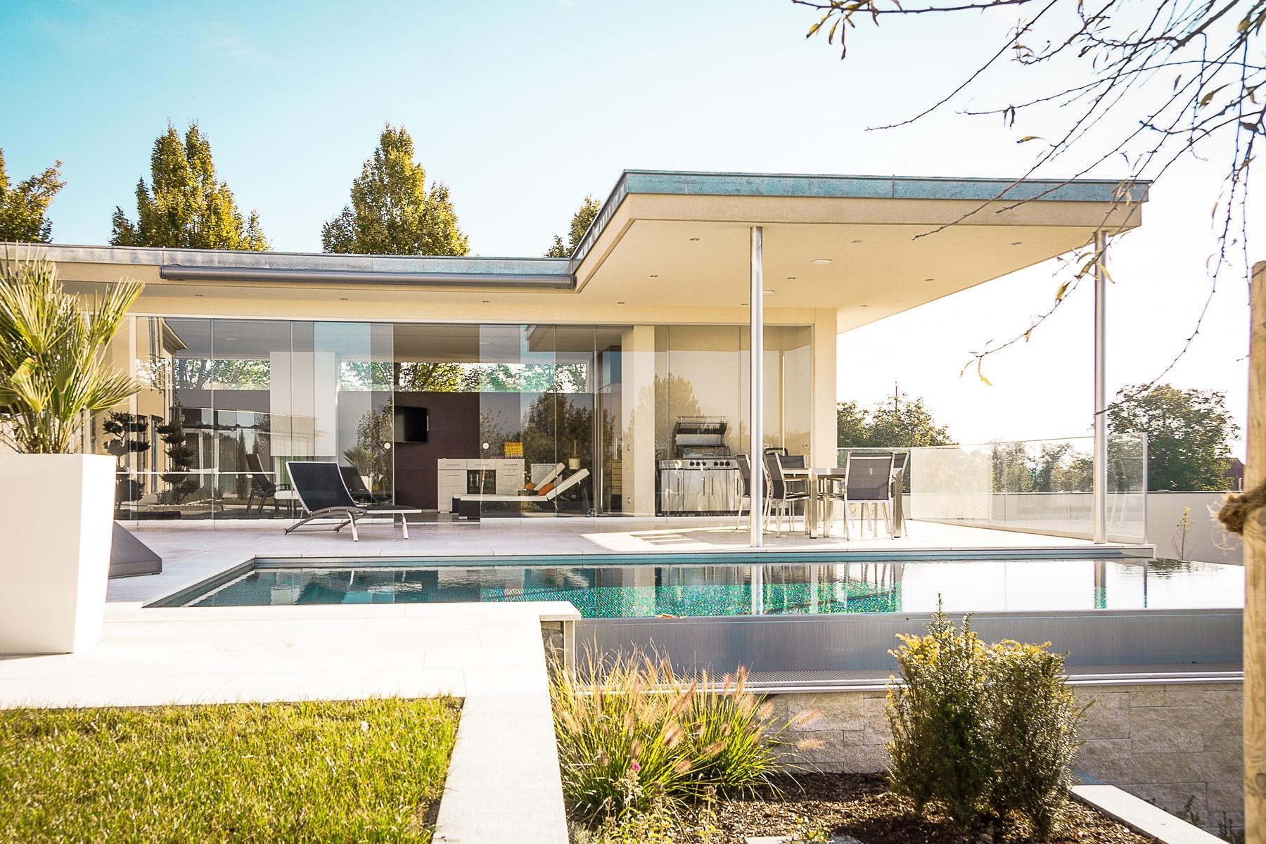 Glasschiebewand für Terrasse als Windschutz