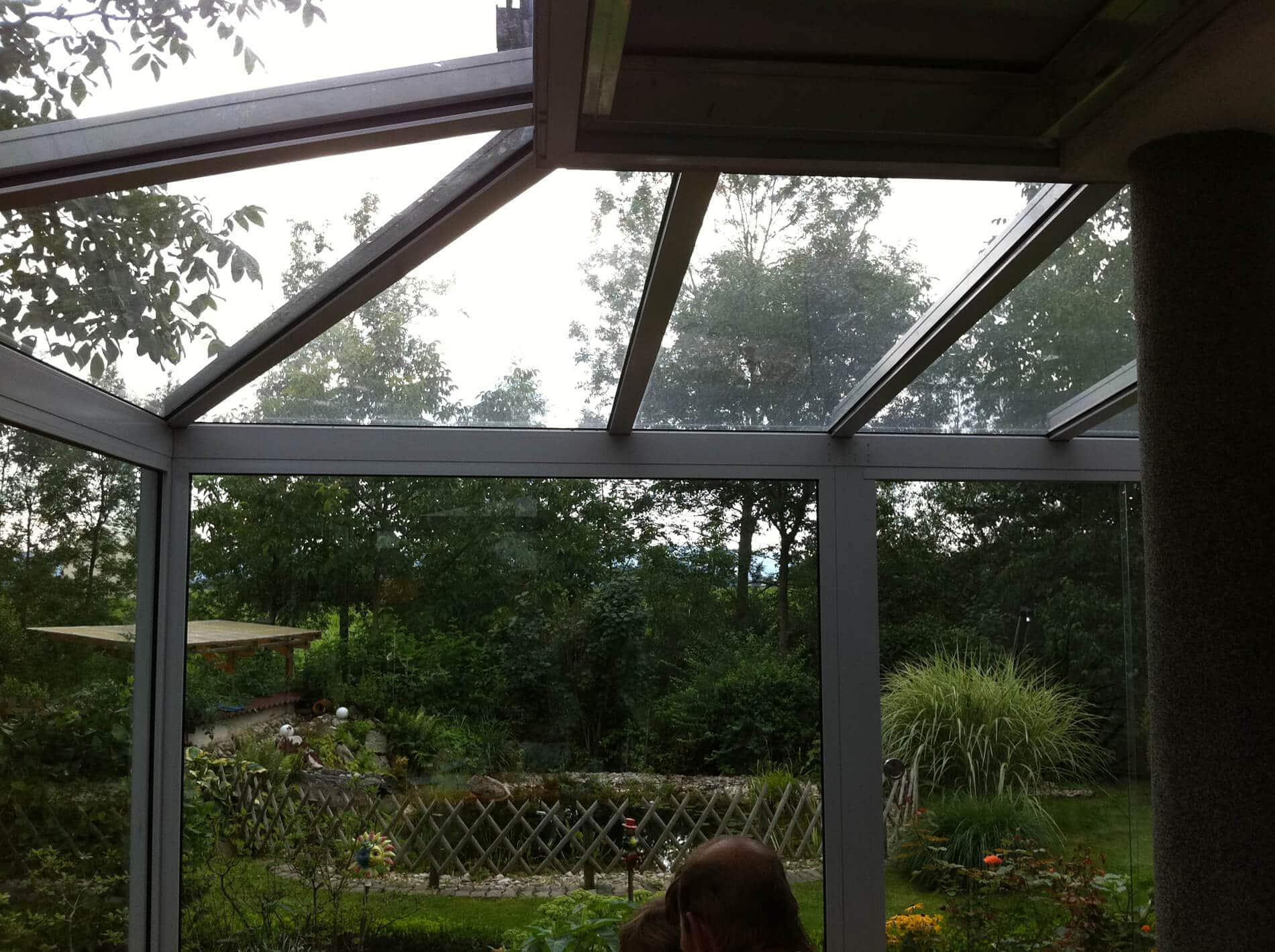Glasüberdachung über eine Ecke