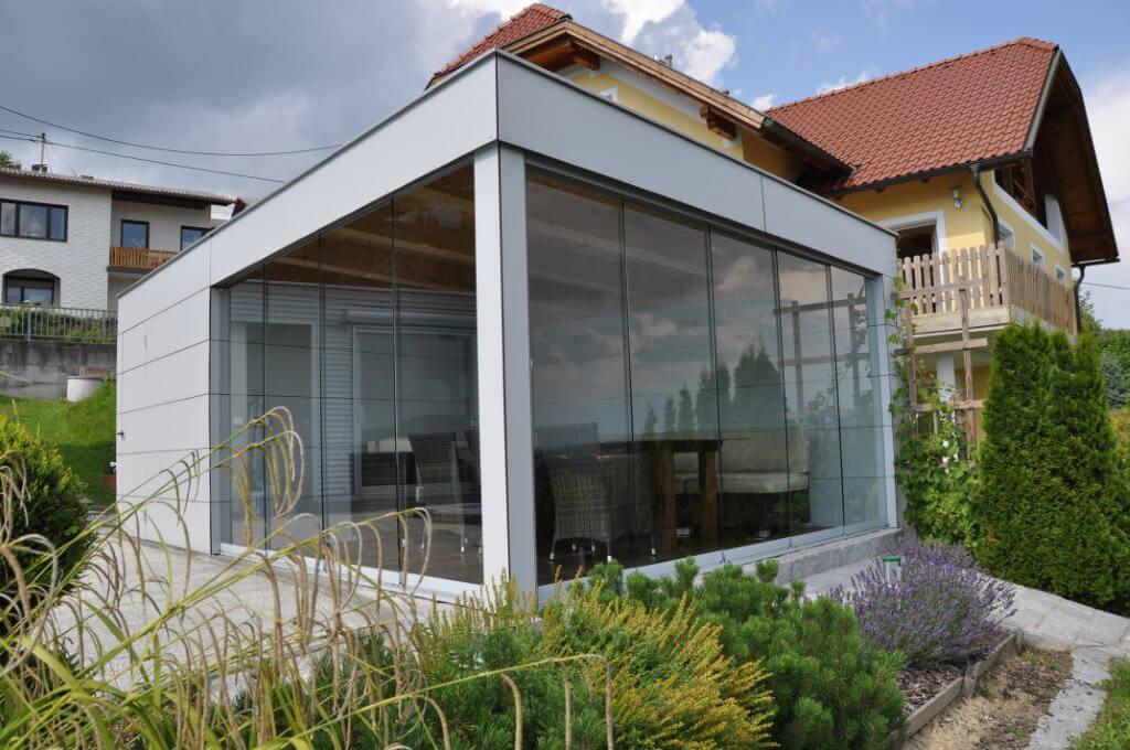 Schiebetürsysteme auf Terrasse aus Glas - Poolhaus