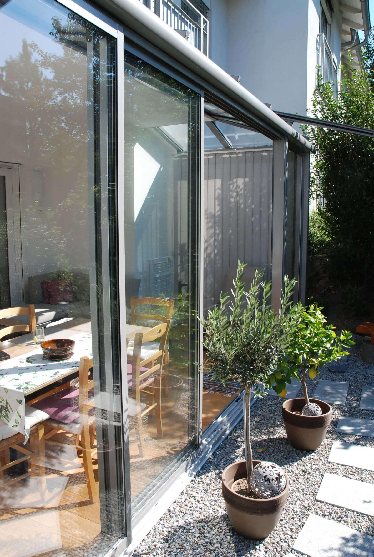 Sommergarten aus Glas und Terrassenüberdachung
