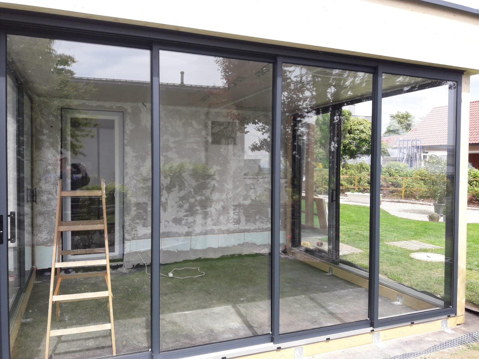 Terrasse verbauen mit Glas
