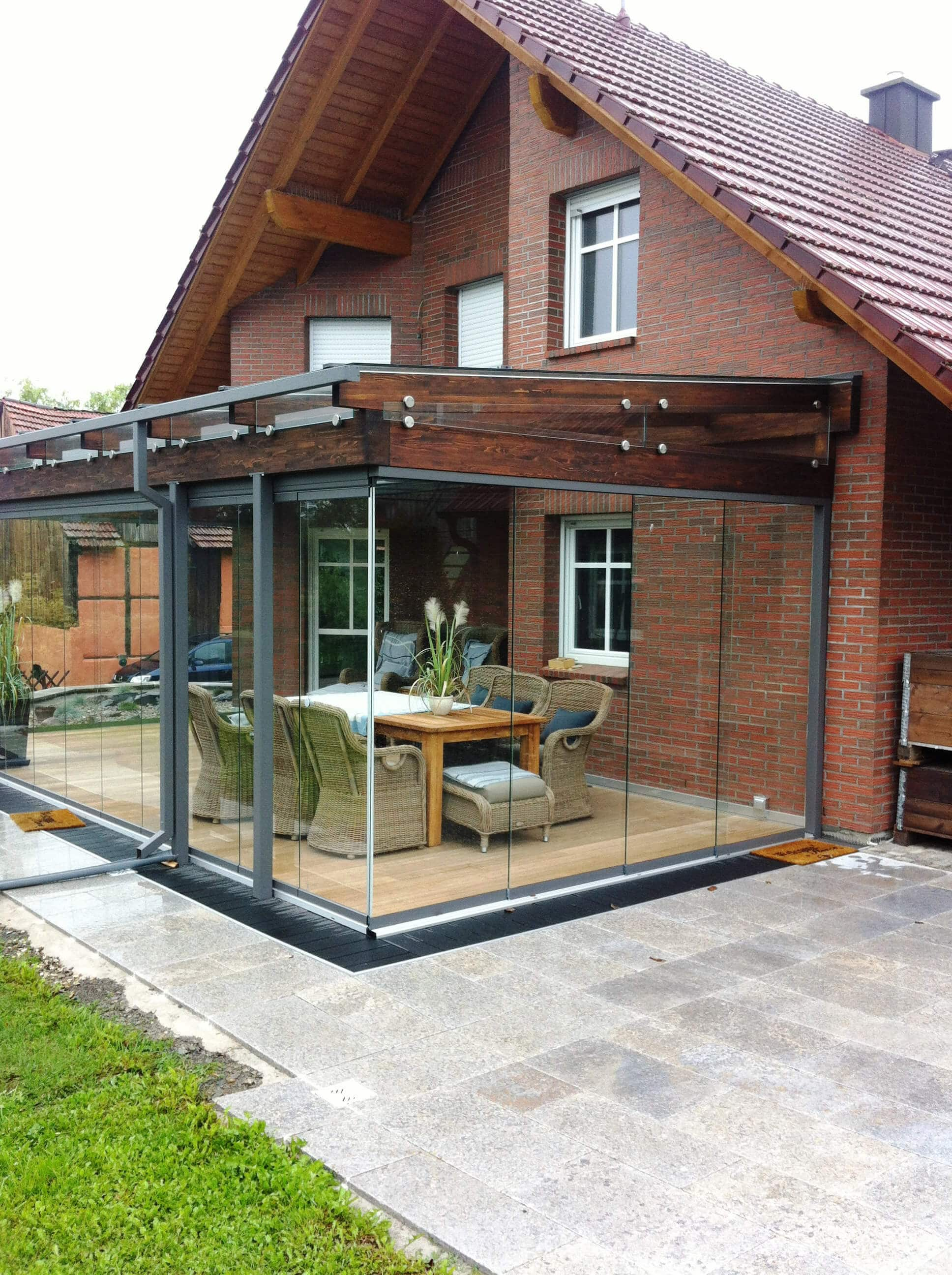 Wintergarten Holz-Alu Konstruktion mit Schiebetüren