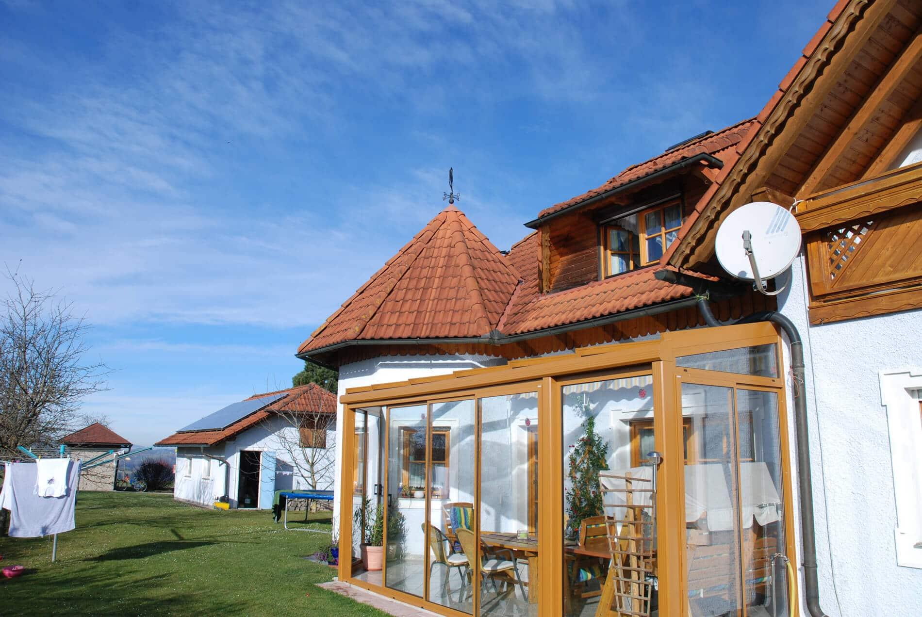 Wintergarten mit Alu Schiebetüren und Glas